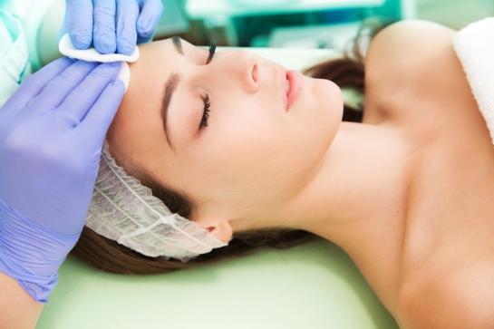 woman at facial cosmetics treatment